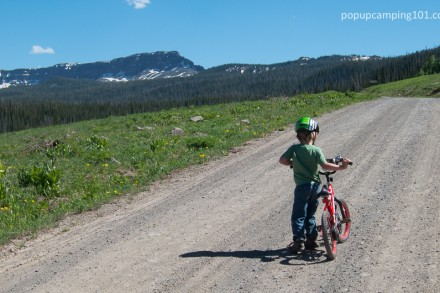 4 year old biking while popup camping