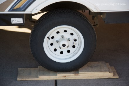 Tire ramp for easier water filling on your popup camper