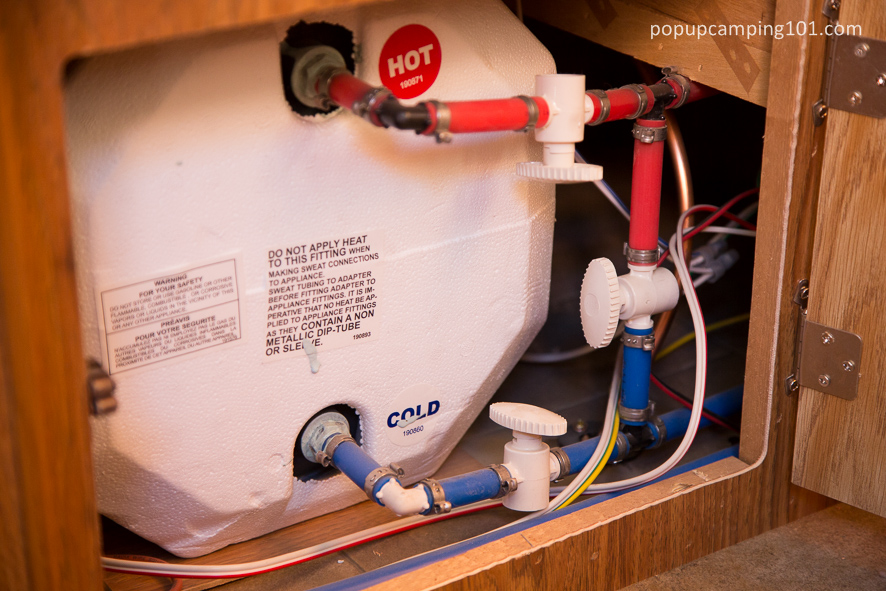 interior view of water heater on a popup camper