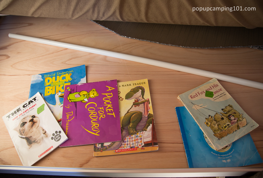 childrens books stored under mattress in popup camper